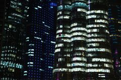 Financial centre in Doha at night, Qatar. QATAR, DOHA, MARCH 20, 2018: Financial centre in Doha at night - capital and most populous city in Qatar, West Bay royalty free stock images