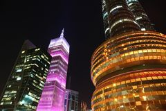 Financial centre in Doha at night, Qatar. QATAR, DOHA, MARCH 20, 2018: Financial centre, NOC and pink Al-Asmakh Towers in Doha at night - capital and most stock image
