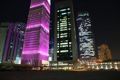 Financial centre in Doha at night, Qatar. QATAR, DOHA, MARCH 20, 2018: Financial centre, pink Al-Asmakh Tower in Doha at night - capital and most populous city stock image