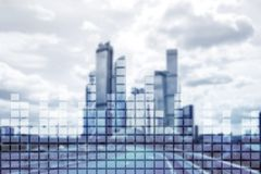 Financial chart on blurred skyscraper office background.  Stock Images