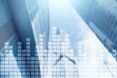 Financial chart on blurred skyscraper office background.  stock photography
