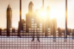 Financial chart on blurred skyscraper office background.  royalty free stock image