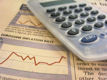 Financial chart and calculator. Calculator over eurozone inflation rate chart Royalty Free Stock Images