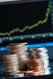 Financial chart and coins Stock Image