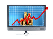Financial chart and coins inside the computer monitor Stock Photo