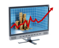 Financial chart and coins inside the computer monitor Stock Photography