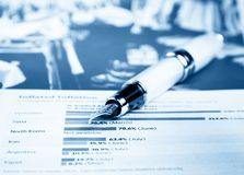 Financial chart and graph near business fountain pen Stock Images