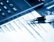 Financial chart and graph near pen and calculator Royalty Free Stock Images