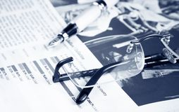 Financial chart and graph near pen and glasses Stock Photography