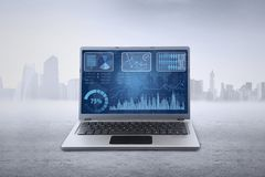 Financial chart on laptop screen outdoors Royalty Free Stock Image
