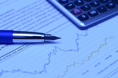 Financial Chart. With Pen And Calculator Royalty Free Stock Photography