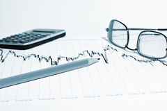 Financial chart and pencil Stock Images