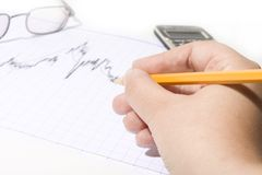 Financial chart and pencil Stock Image