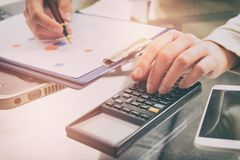 Financial chart report concept with calculator Royalty Free Stock Photography