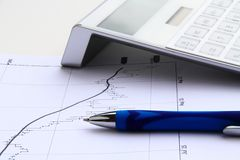 Financial chart with solar calculator Stock Photo