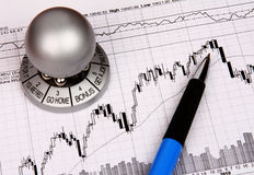 Financial chart with a souvenir Stock Photos
