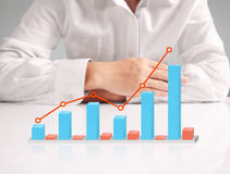 Financial chart symbols coming from  hand. Financial chart symbols coming from a hand Stock Photography