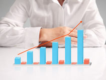 Financial chart symbols coming from  hand. Financial chart symbols coming from a hand Royalty Free Stock Photography