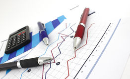 Financial chart. Three pens on papers with the financial chart royalty free stock image