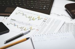 Financial charts of currencies on paper, profit analysis, financier`s workplace royalty free stock images