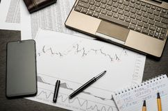 Financial charts of currencies on paper, profit analysis, financier`s workplace stock images