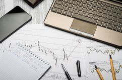 Financial charts of currencies on paper, profit analysis, financier`s workplace royalty free stock image