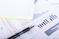 Financial Charts and Graphs on Business Table Stock Photo
