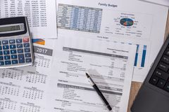 Diagrams, financial report  computer and pen on wooden desk Stock Photography