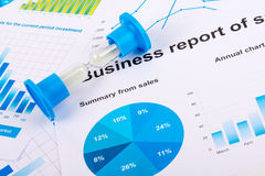 Financial charts and graphs. Sales report on paper Royalty Free Stock Photos