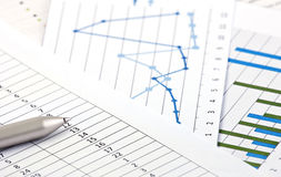 Financial charts and graphs on the table Stock Photo