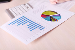 Financial charts and graphs on the table Stock Photography