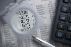 Financial charts. Magnifying numbers. Royalty Free Stock Photos