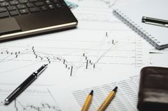 Financial charts on paper, analysis and calculations royalty free stock photography