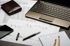 Financial charts and reports on paper, currency analysis, broker`s workplace royalty free stock images