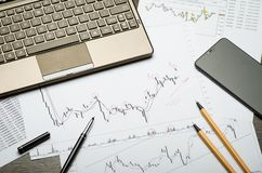 Financial charts and reports on paper, currency analysis, broker`s workplace stock images