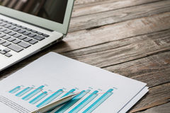 Financial charts on the table Stock Photos