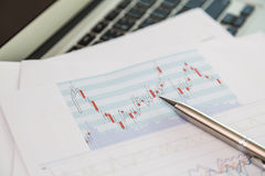 Financial charts on the table Stock Images