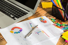 Financial charts on the table Stock Photography