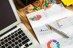 Financial charts on the table Royalty Free Stock Photos