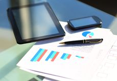 Financial charts on the table Royalty Free Stock Photo