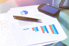 Financial charts on the table with tablet and pen Royalty Free Stock Photo