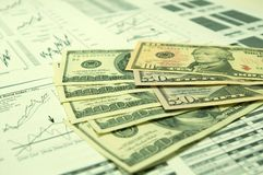 Financial charts and US Dollar #5. US Dollar together with various financial charts Stock Photos