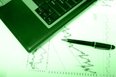 Financial charts w green overlay. Financial stock charts w green overlay stock photo