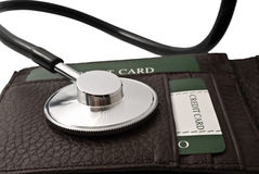 Financial checkup. Diagnose finance situation, a stethoscope on wallet Royalty Free Stock Photo