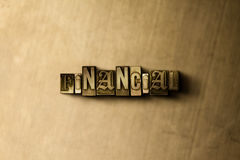FINANCIAL - close-up of grungy vintage typeset word on metal backdrop. Royalty free stock illustration.  Can be used for online banner ads and direct mail Royalty Free Stock Photography