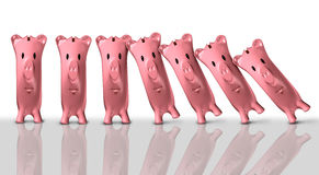 Financial Colapse Concept. Financial collapse concept and economic crisis symbol as a group of piggy banks falling like domino pieces as a finance trouble and Stock Photos