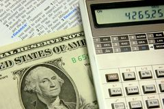Financial concept. Mortgage calculations concept, a dollar bill and a calculator stock photography