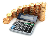 Financial concept. Calculator and gold coins. Stock Photos