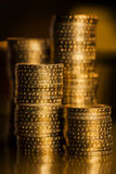 Financial concept. Coins closeup. Gold bars, money and financial concept Stock Images