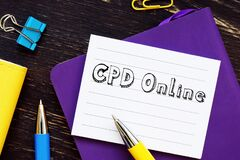 Financial concept about CPD Online Continuing Professional Development with inscription on the sheet